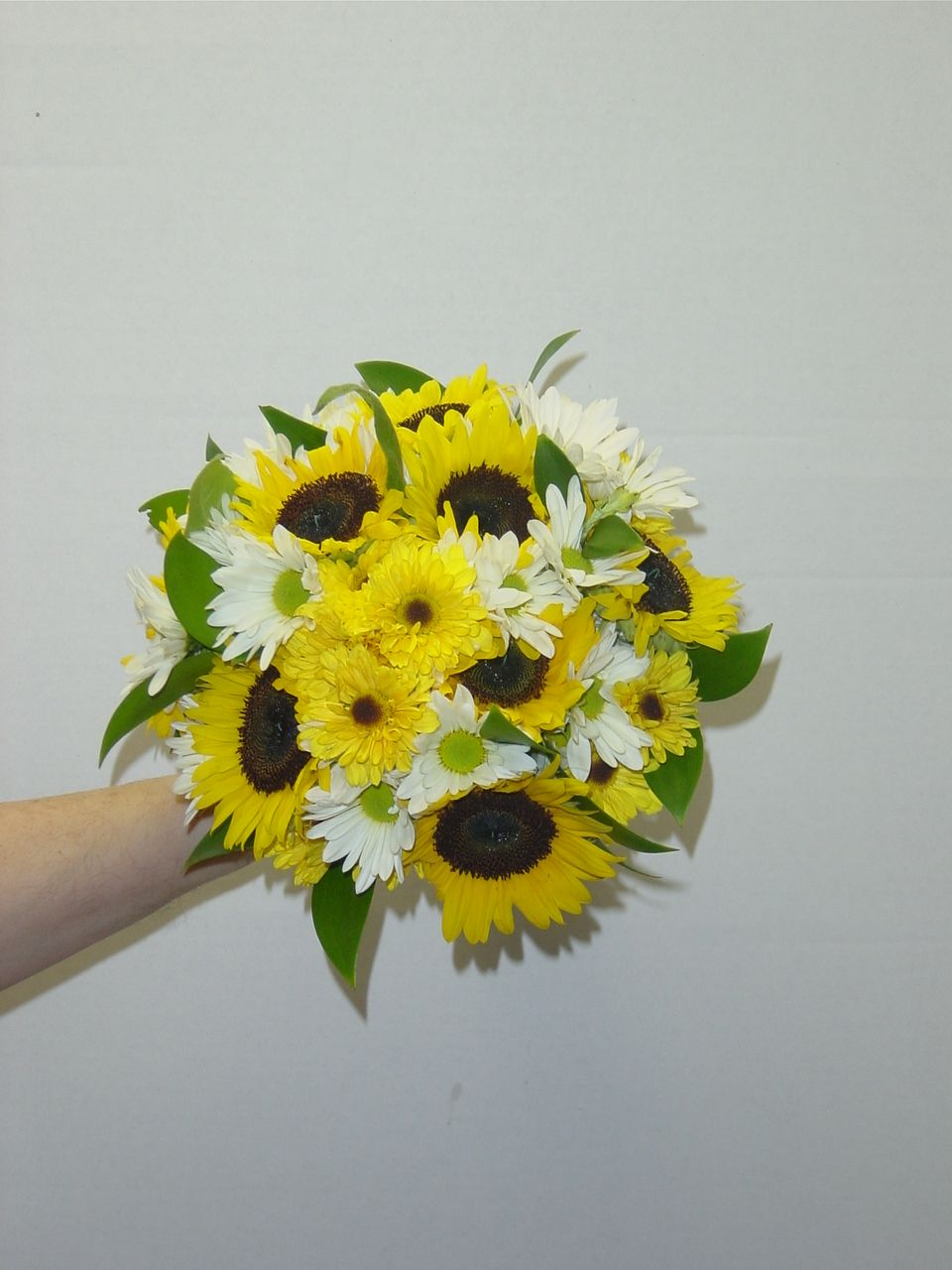Yellow weddings:  Bouquet of sunflowers and two types of daisy mums. Designed by WhimsicalWelcomes.com