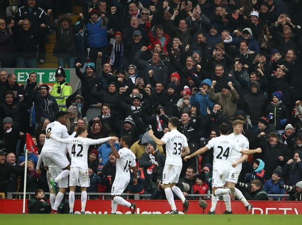 Fernando Llorente of Swansea City (L/obscure) celebrates scoring his sides first goal during the Premier League match between Liverpool and Swansea City at Anfield on January 21, 2017 in Liverpool, England.