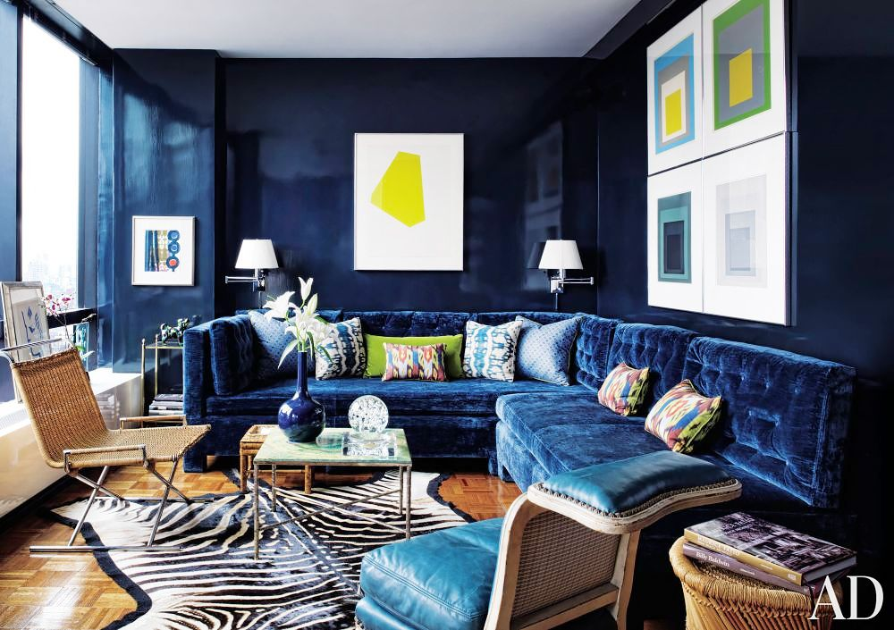 The One Piece Of Furniture You Never Knew You Needed Until Now Navy Blue Living Room Lacquered Walls Blue Living Room