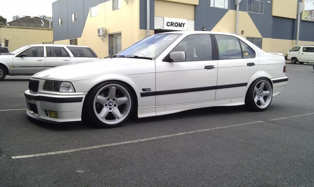 White BMW e36 sedan on classic AC Schnitzer type 2 mono