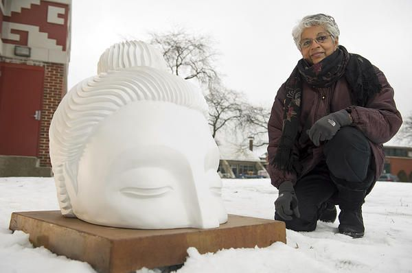 Dozens of giant Buddha heads emerging around Chicago are meant to be a catalyst for conversations about peace in troubled neighborhoods.
