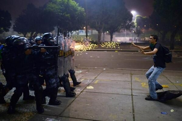 Police fire rubber bullets at a protester during clashes in Rio de Janeiro on Thursday, June 20, 2013. Demonstrations in Brazil began in res...