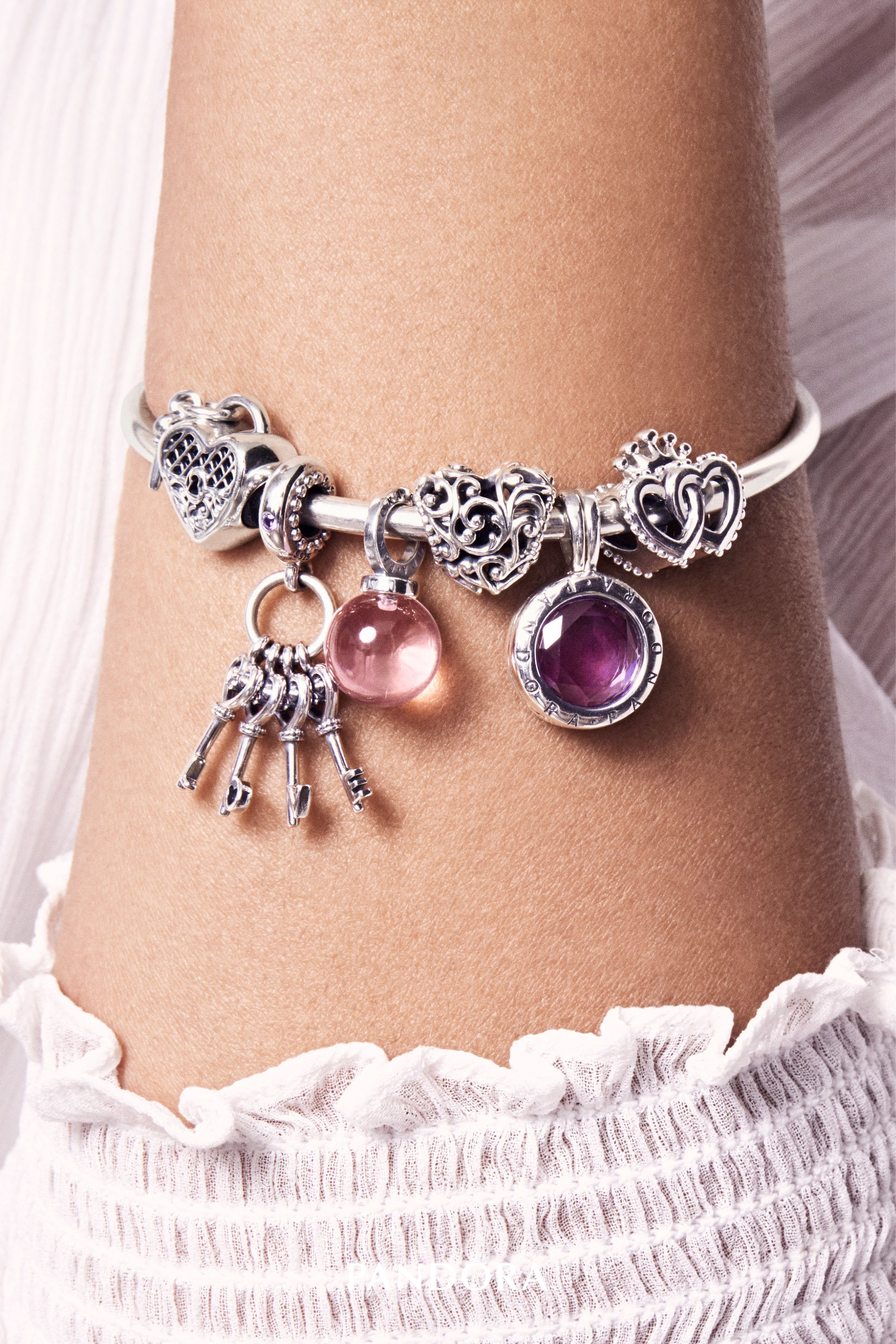 29b8cbc9f Let your style reign supreme with new and beautifully crafted charms and  bracelets. Tonal pink and purple stones radiate regal elegance on the new  ...