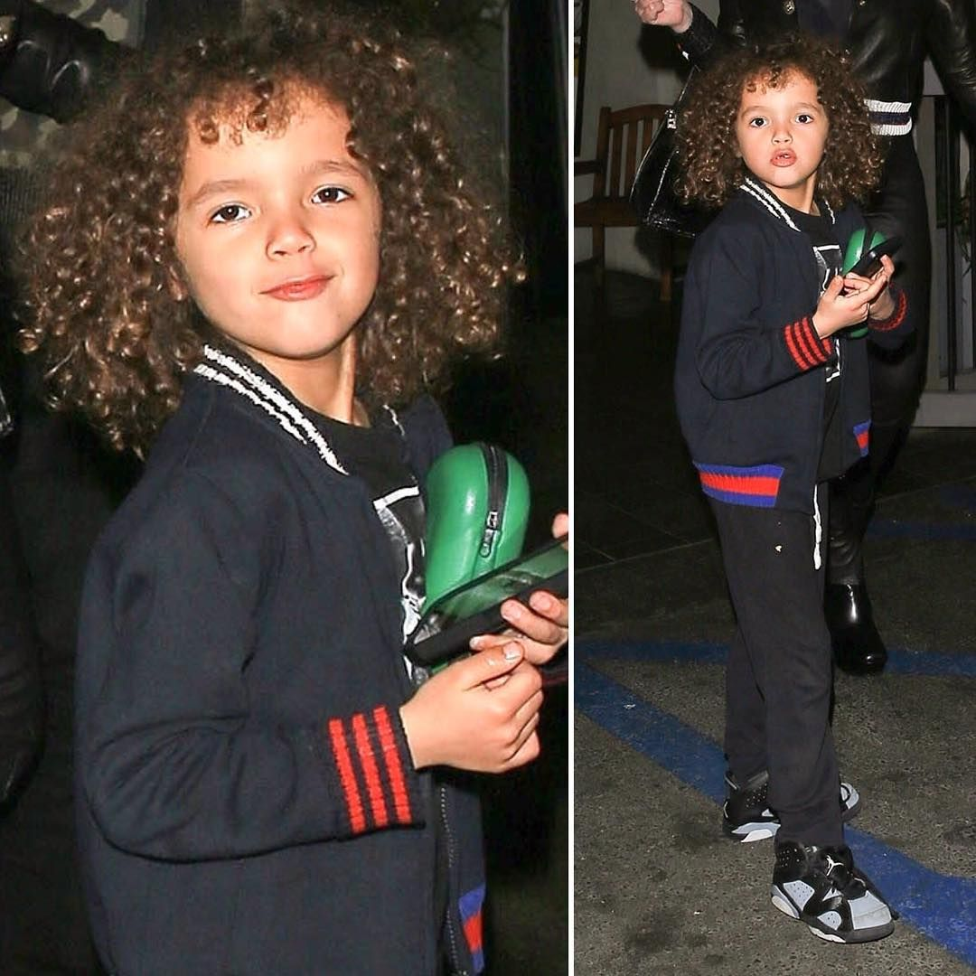 CUTE! Mariah Carey was spotted with her son Moroccan Cannon and boyfriend Bryan Tanaka in LA. Both Mariah and Moroccan were wearing GUCCI outfits. Love this GUCCI boys blue varsity style jacket that Moroccan is wearing with the classic GUCCI stripes. Inspired by the GUCCI men's collection, this streetwear look looks perfect with a pair of black pants, t-shirt, and sneakers.  #mariahcarey #celebrity #celebritykids #gucci #guccikids #boys #kidsfashion #minime #fashion #style