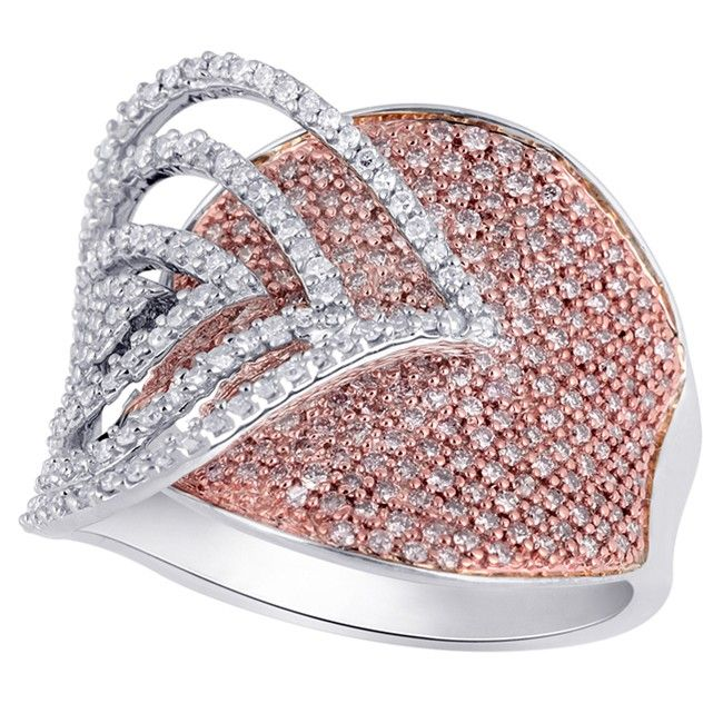 It's the kind of ring that will leave someone speechless. With a sumptuous concave band of rare natural pink diamonds set in rich rose gold, offset by four leaf shaped trims of dazzling white diamonds set in cool white gold, this ring is a truly unique creation to treasure.