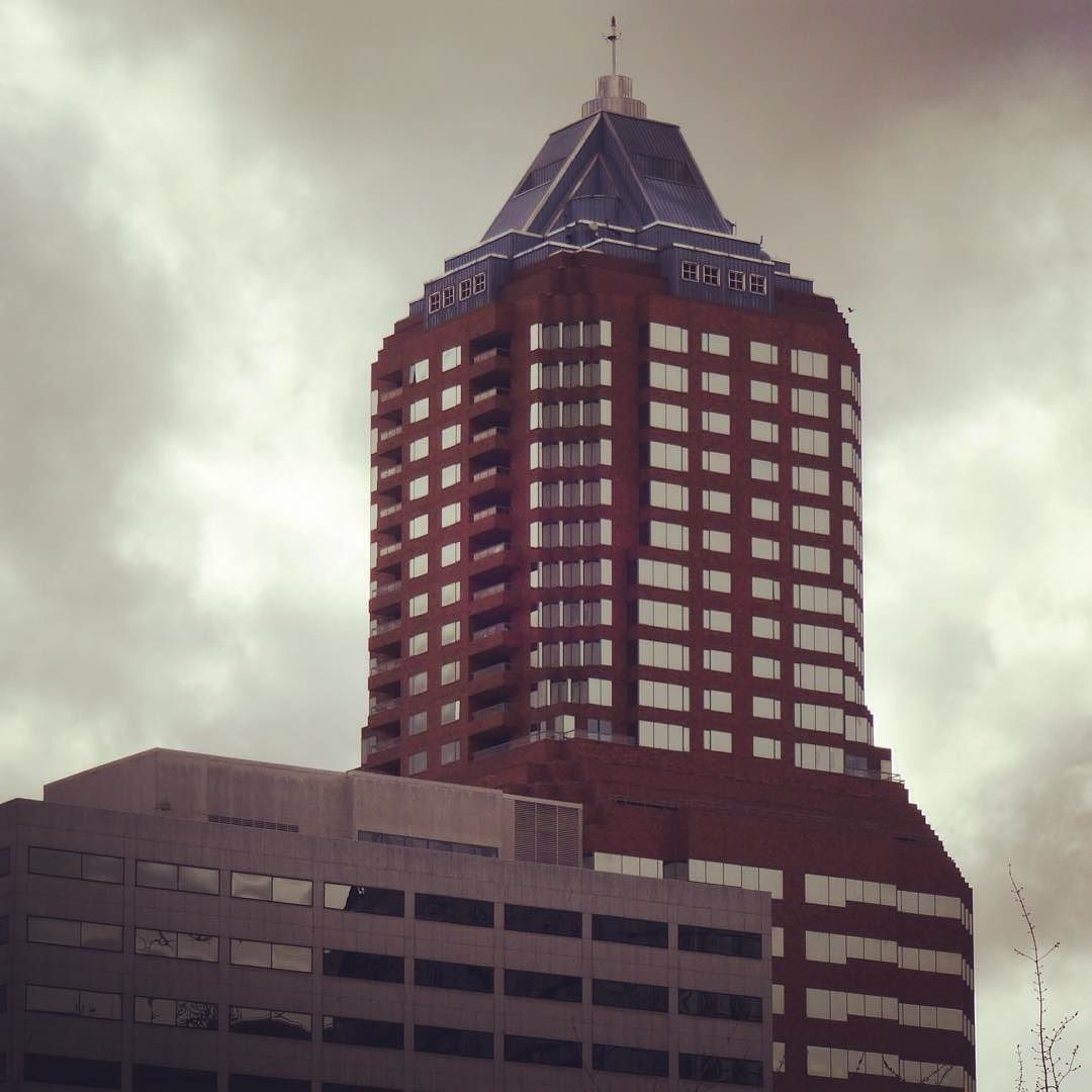 KOIN Center building #portlandoregon #portlanddowntown #portland #koincenter #architecturephotography #arxhitecture #glass #building #clouds