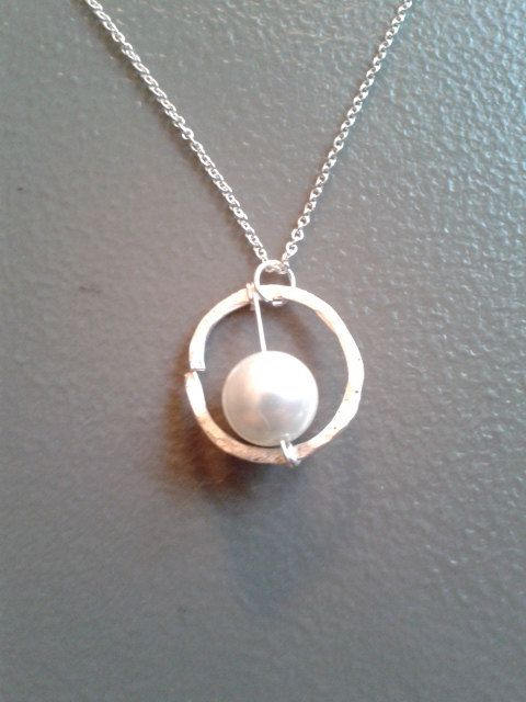 This necklace has a pearl with a sterling silver plated copper wire border. The chain is made of .925 sterling silver and measures approximately 18 inches. The pendant measures approximately 1 inch wide and long. Buy yours at https://www.etsy.com/listing/197417954/pearl-with-sterling-silver-plated-wire?ref=shop_home_active_3  For a matching pair of earrings, visit https://www.etsy.com/listing/191634216/pearls-with-sterling-silver-ring?ref=shop_home_active_11