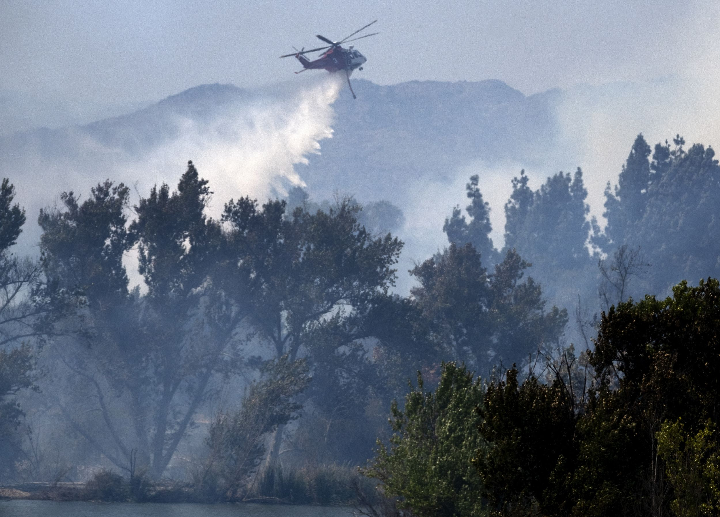 Sept 06 2020 A Los Angeles Fire Department Helicopter Makes A Water Drop Over A Brush Fire In The In 2020 California Wildfires Los Angeles Fire Department Brush Fire