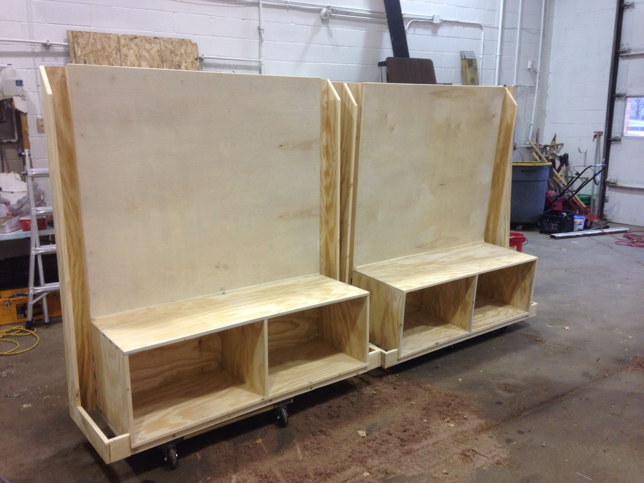 benches with cubbies and hockey stick holders for an ice rink