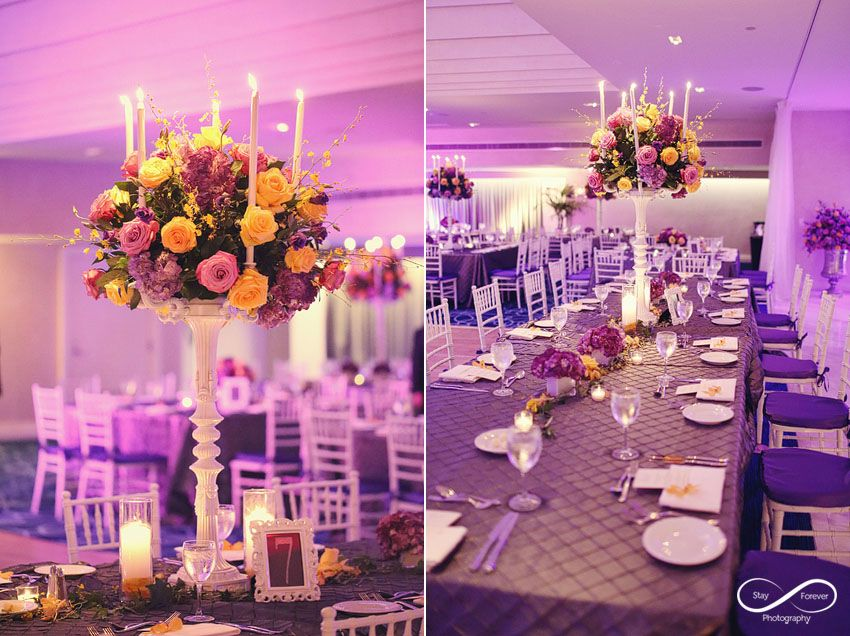 Boca By Design A Tall White Candelabra With Mixed Colored Roses