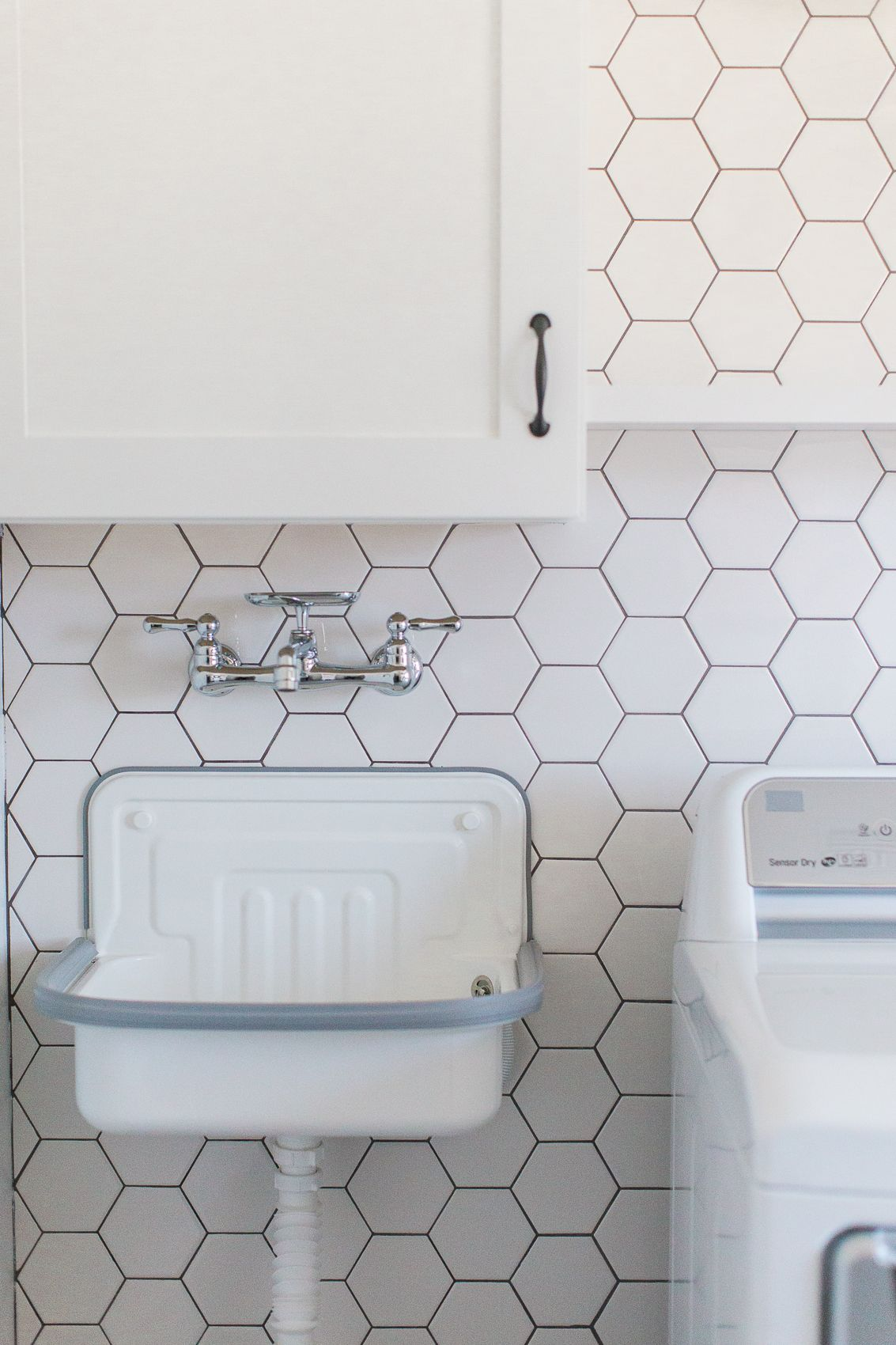 Wall Mounted Laundry Sink And Faucet With Hexagon Tile Accent