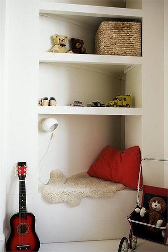 Use a deep big shelf that's big enough to climb into. | 21 Cozy Makeshift Reading Nooks
