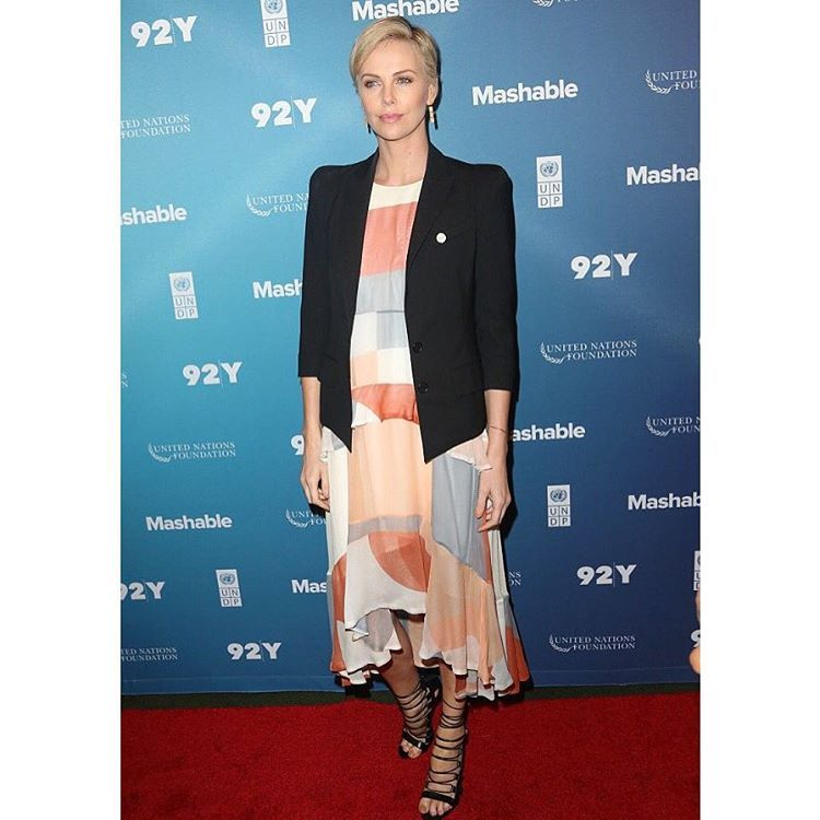 """SCOOP NYC on Instagram: """"Charlize rocking her Aquazzura Amazon sandals at the 2015 Social Gold Summit! Available in our stores #scoopnyc #charlizetheron #aquazzura"""""""