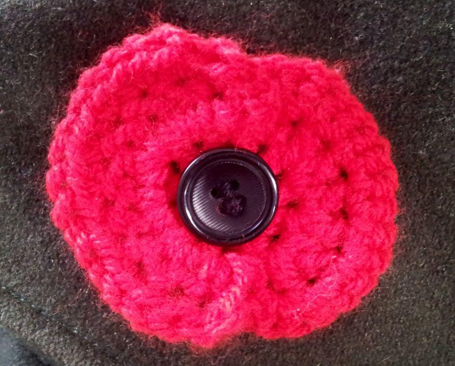 Crochet Poppy on coat | Crochet | Pinterest