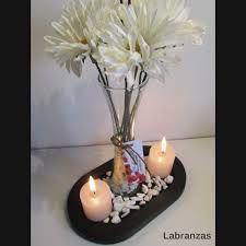 resultado de imagen para centro de mesa con floreros de vidrio para quince