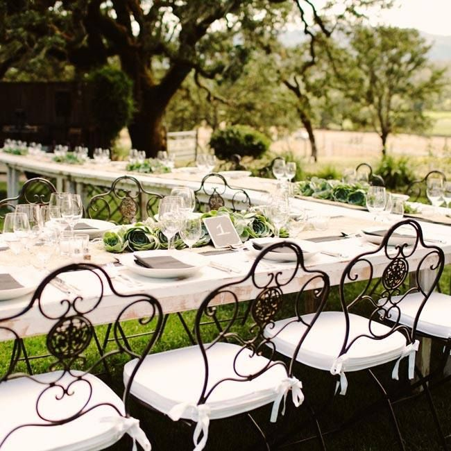 There are other types of chairs to use at a wedding besides the Chiavari chair - I love the elegant design on these metal ones