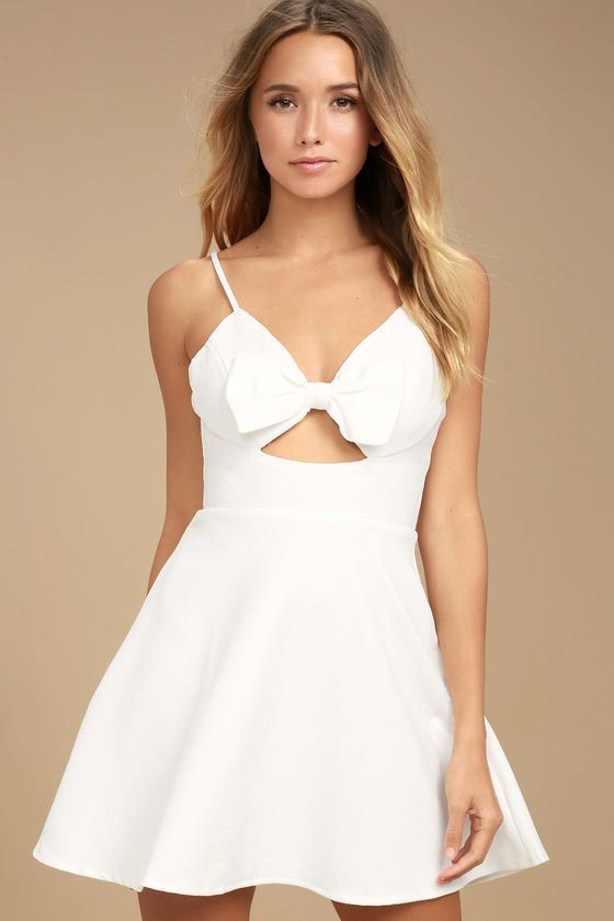 e34ee5eb91 Trust us when we say the Better Bow-lieve It White Skater Dress is the  cutest dress we ve ever seen! Textured woven poly shapes this sweet and sexy  skater ...