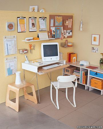 Use of pegboard to create a workable space: hang clipboards, shelves, wire baskets to clear off desktop and have tools nearby