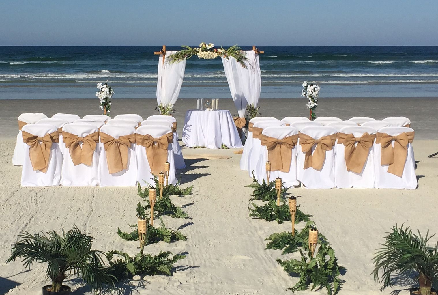 Maya Four Post Bamboo Arch With White Burlap At Beach Wedding In New Smyrna