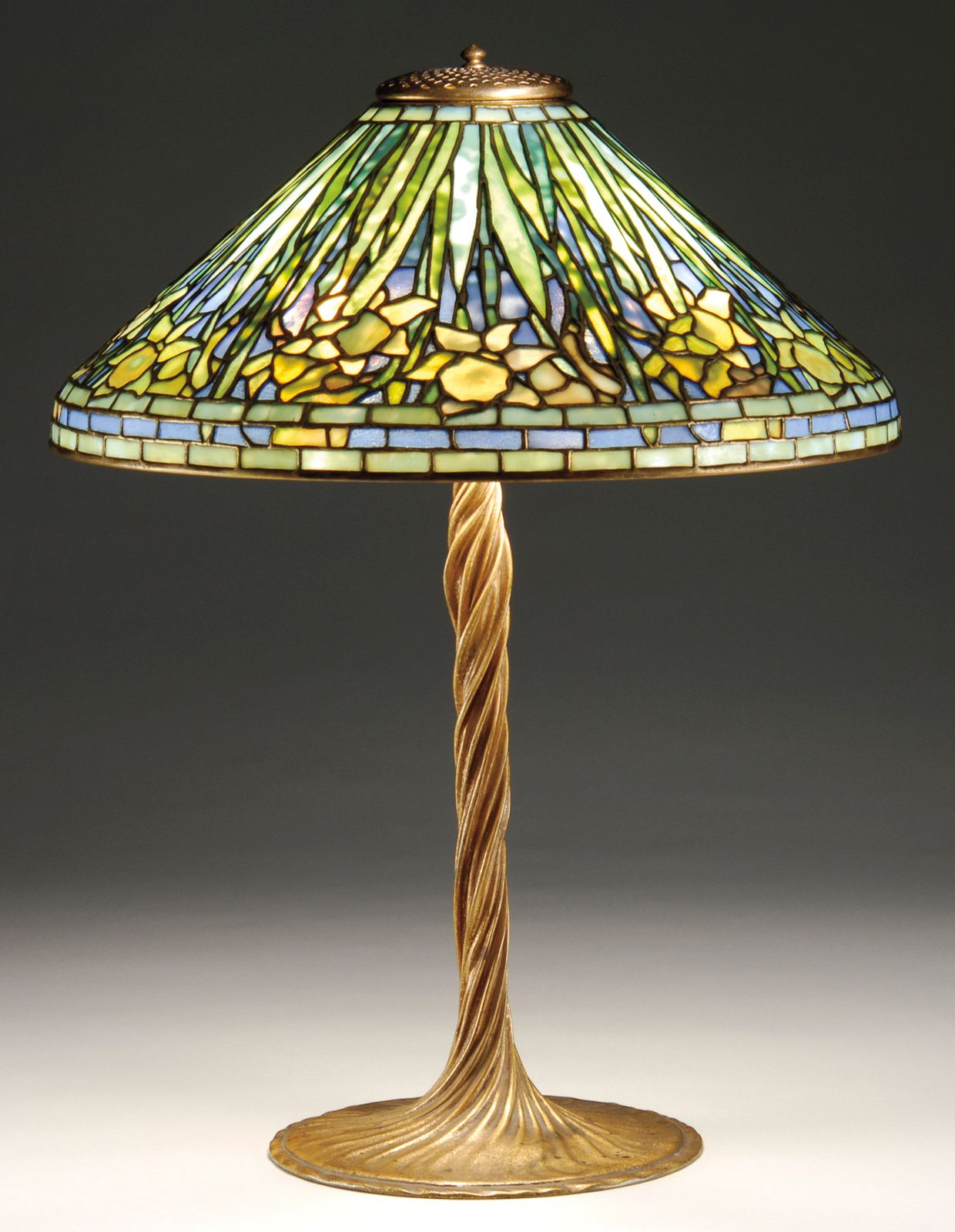 A beautiful daffodil table lamp on its original twisted vine base.