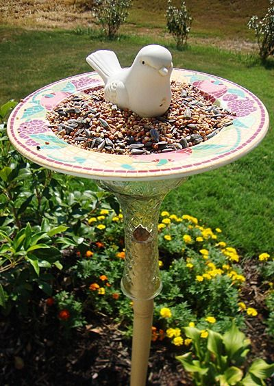 an old glass vase glued to a large platter/bowl for a bird bath