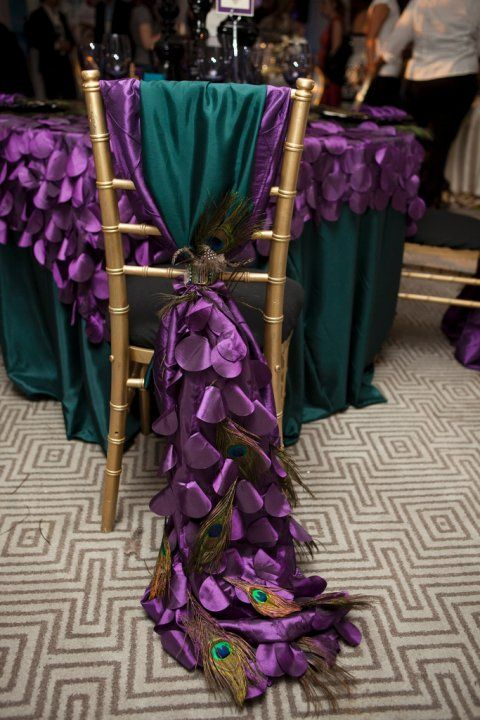 Peacock Wedding Chair Cover. http://memorablewedding.blogspot.com/2013/10/are-peacock-wedding-feathers-right-for.html