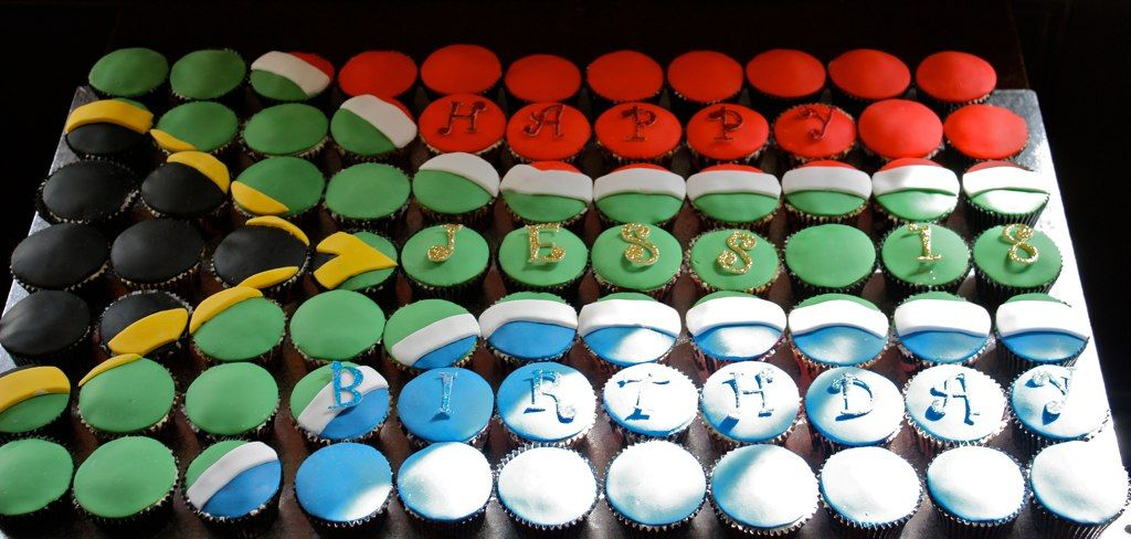 South African flag cupcakes--This South African flag cupcake cake is made up of 77 cupcakes (half lemon, half red velvet) and is by the UK's Cake by Sugar (via Flickr). See www.cakebysugar.com for ordering information.
