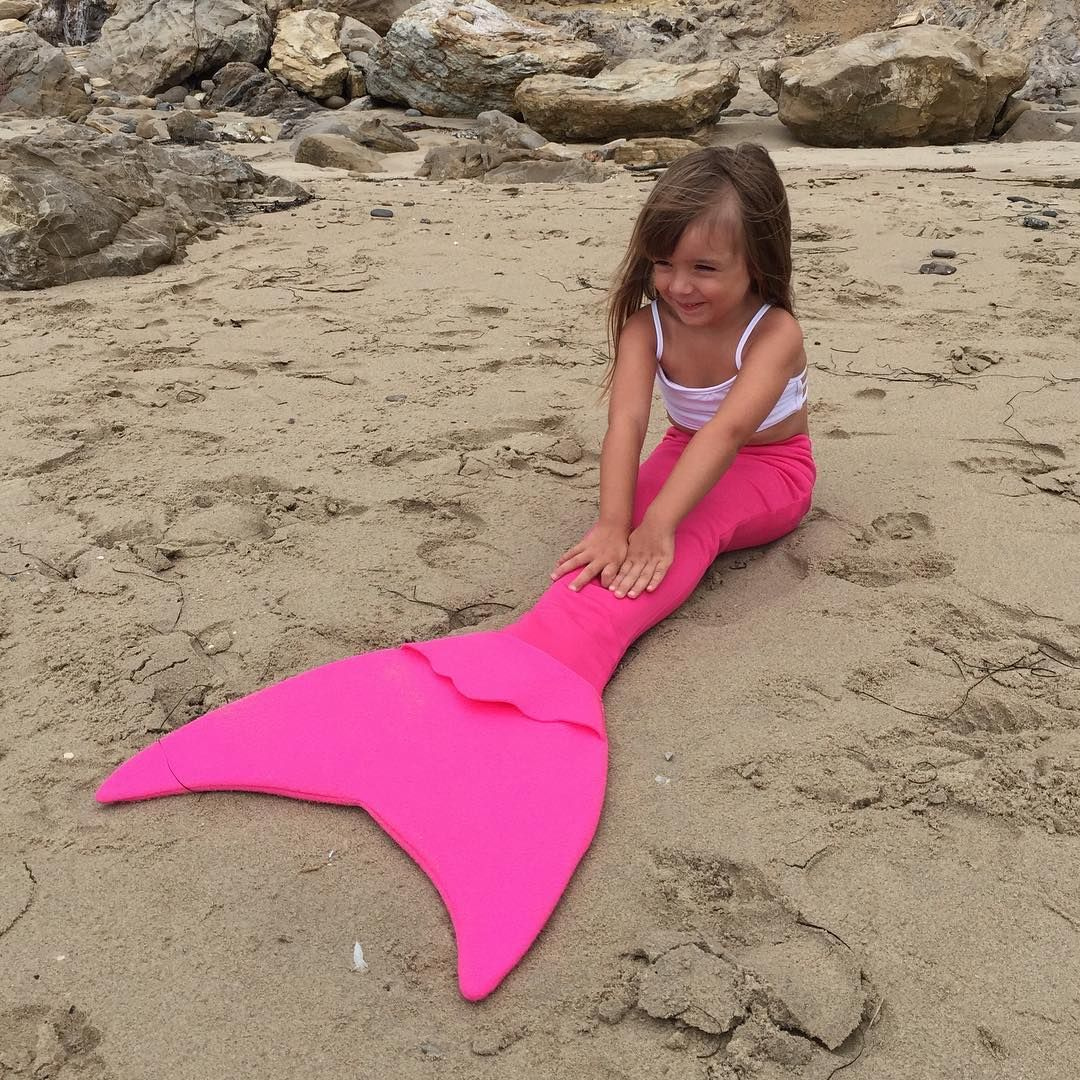 An essential this Spring and Summer! Have you snagged our Mermaid Tails yet!? ✨☀️ Violet looks so cute in our Mini Mermaid Tail in Hot Pink! We have 4 sizes and so many colours available on our website! #flexileximermaidclub (cr: @coffeeandrainbows)