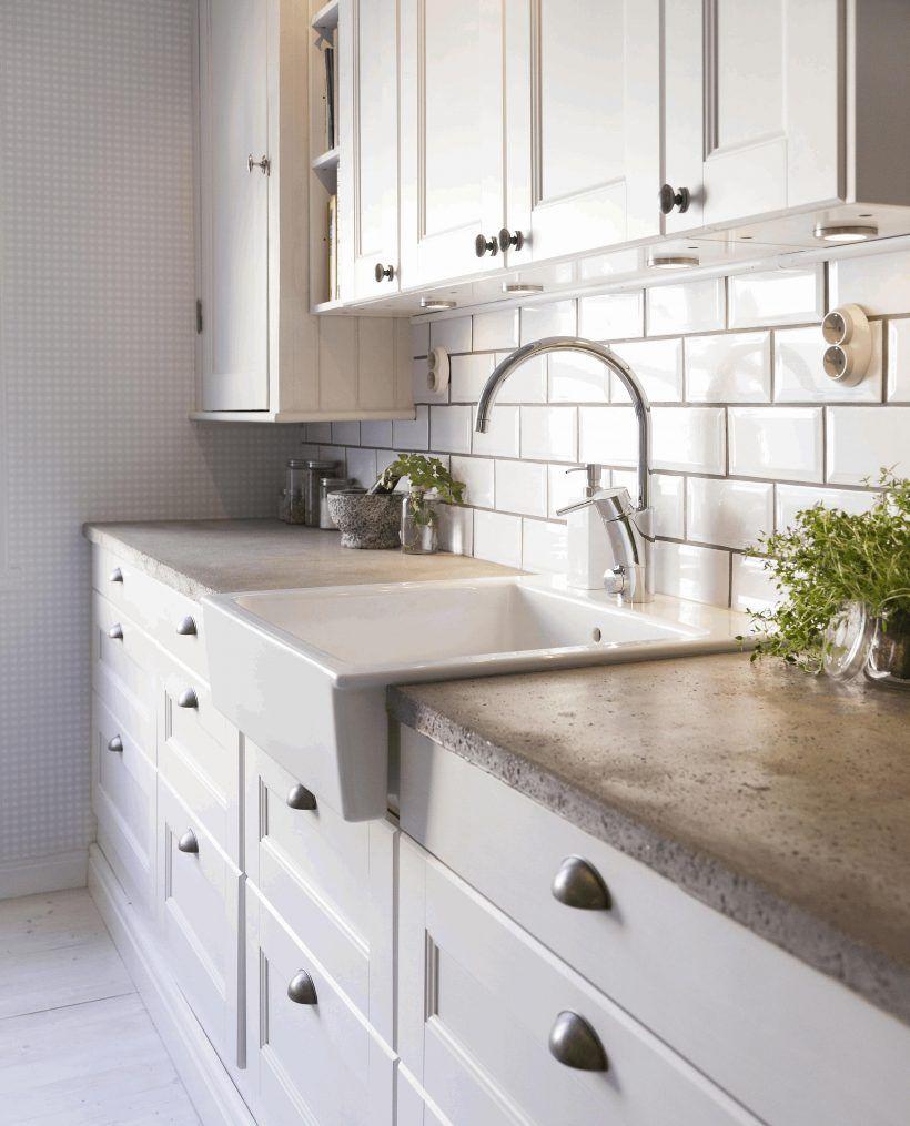 modern-kitchen-concrete-countertops-light-brown-wooden-table-white ...