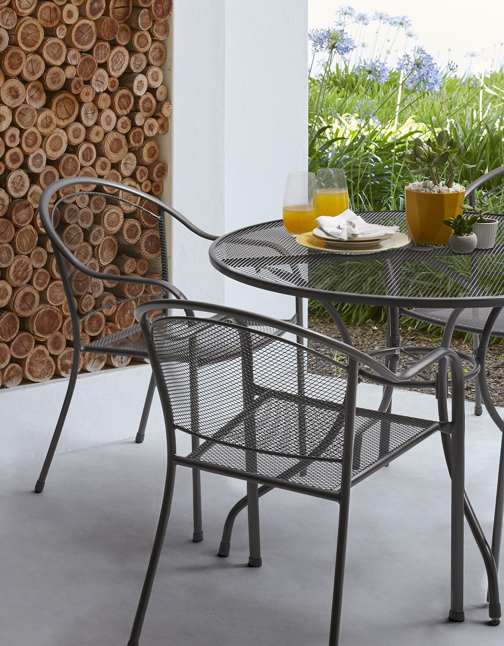 Dine in style in the great outdoors with this ontario metal dining set available at