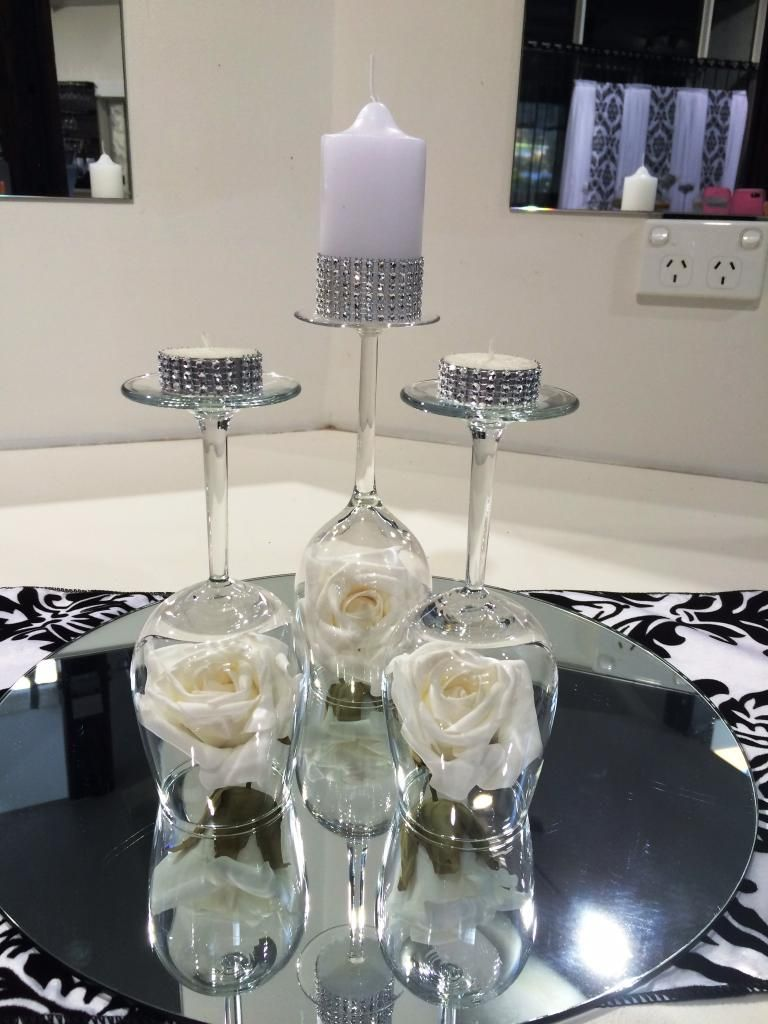 Upside down wine glasses centerpiece pinterest for Wine centerpiece ideas