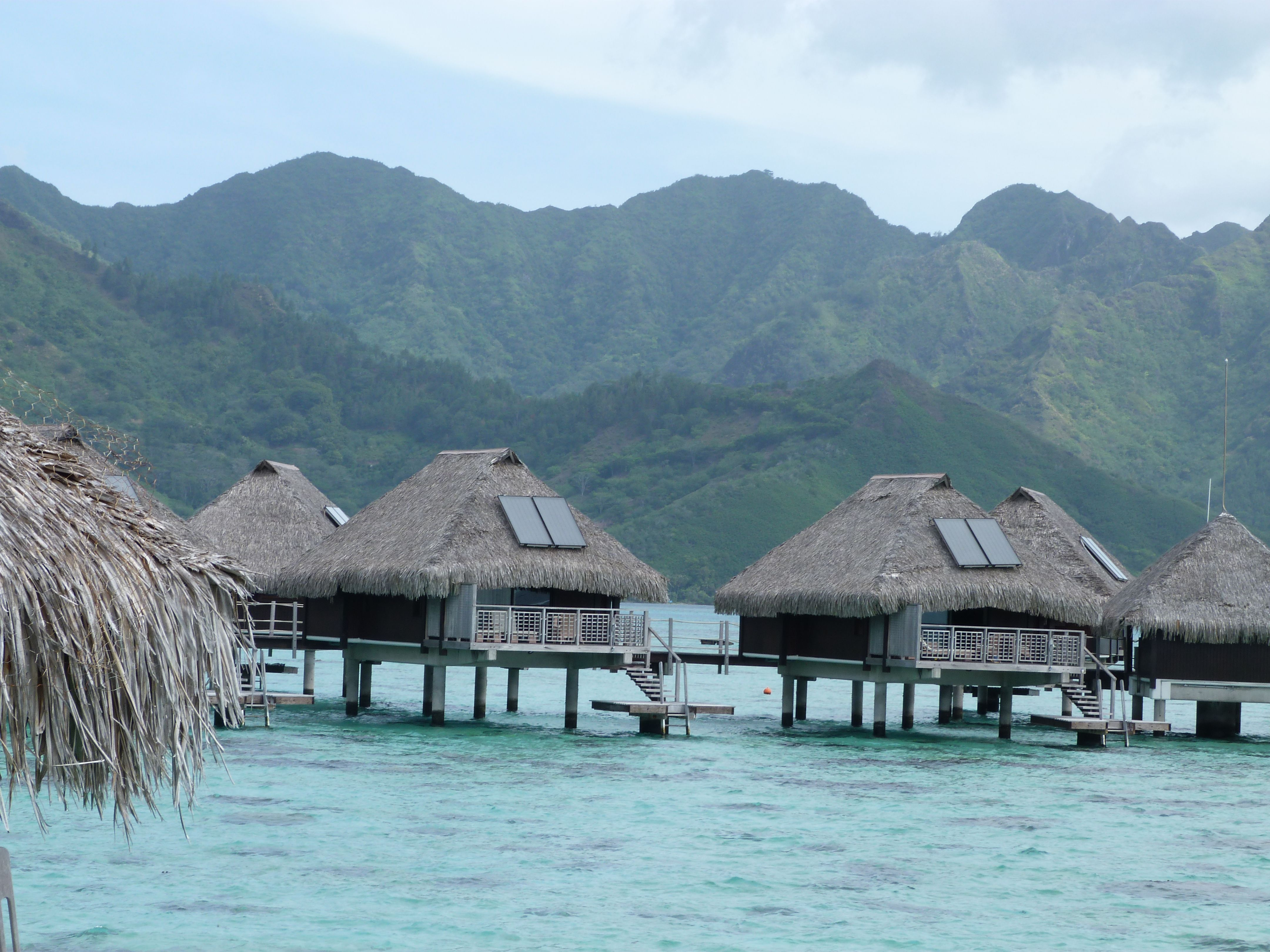 Over the Water Bungalows off the Island of Moorea in the South Pacific