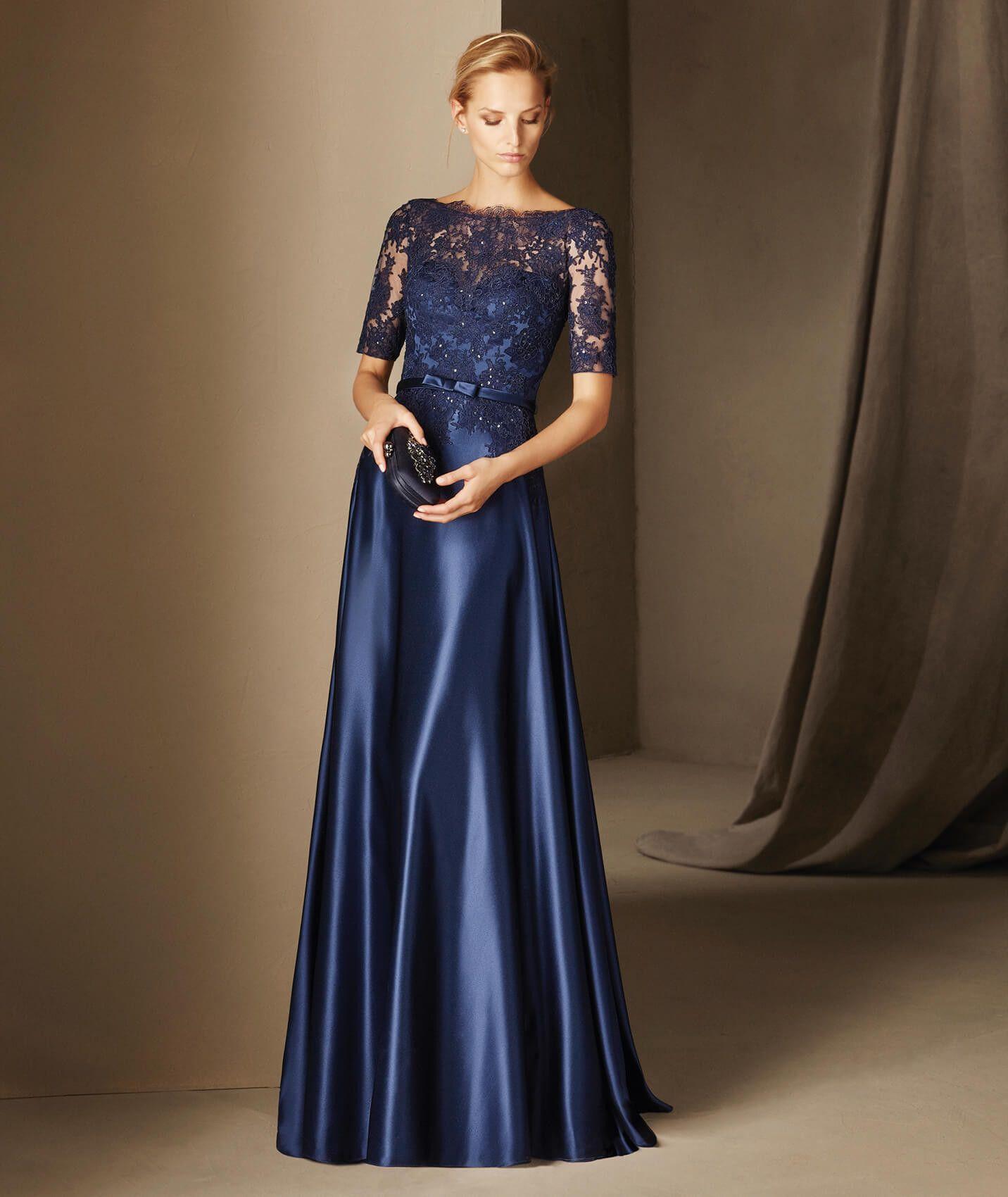 BOADA nedime elbisesi, bele oturan, kayık yaka, şık bir seçimdir ve yapılmış olduğu tül ve dantel, romantik bir biçimde esinlenilmiş unsurlardır.