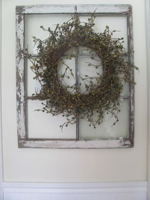 Hide your thermostat using an old window and a wreath ...