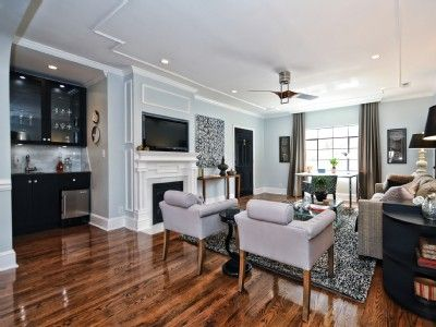 Large living room includes wetbar, fireplace and a flatscreen television.