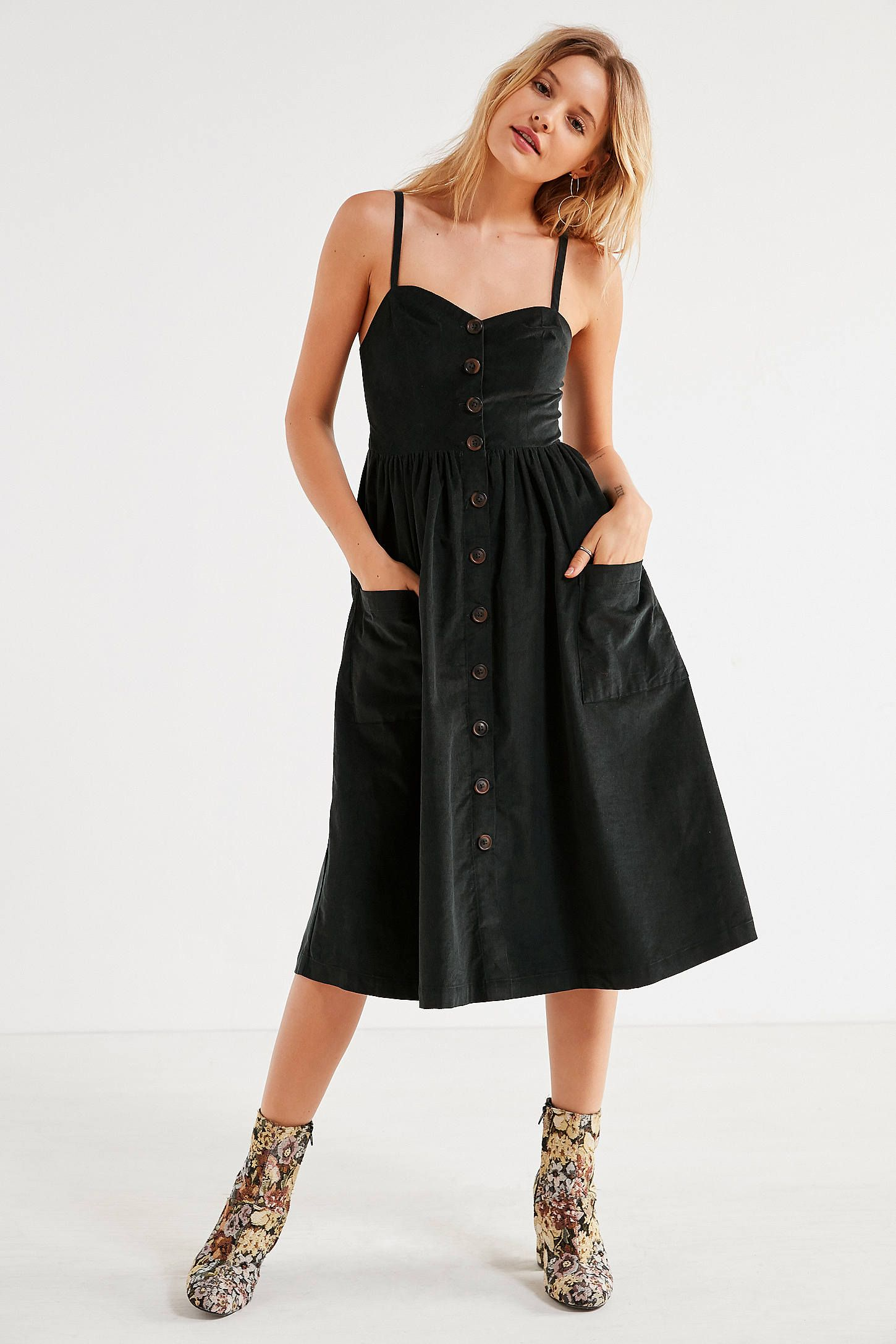 2a73817775 Shop UO Emilia Corduroy Button-Down Midi Dress at Urban Outfitters today.  We carry all the latest styles