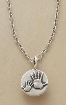 A Mother and Child Handprint Necklace, to honor that most special relationship.