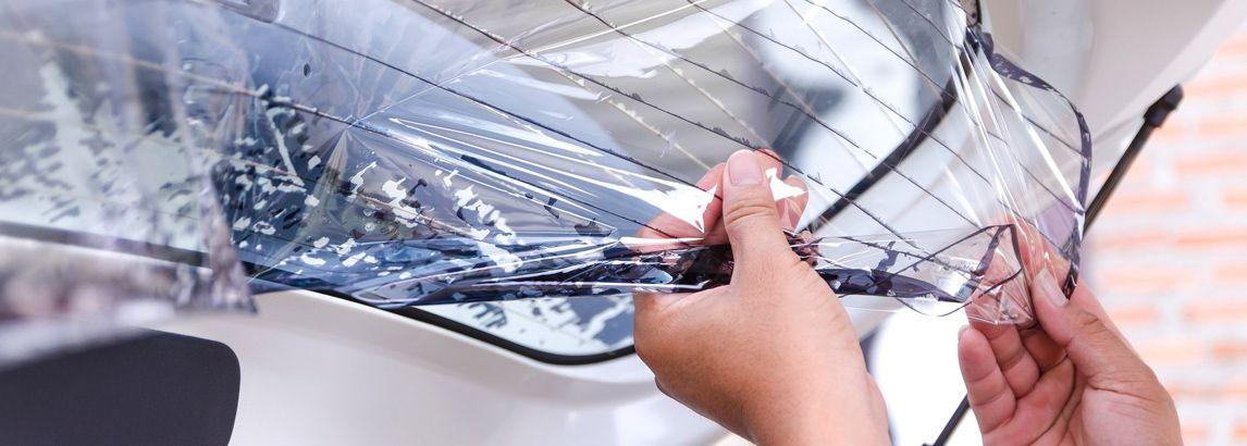 how to remove window tint glue from glass