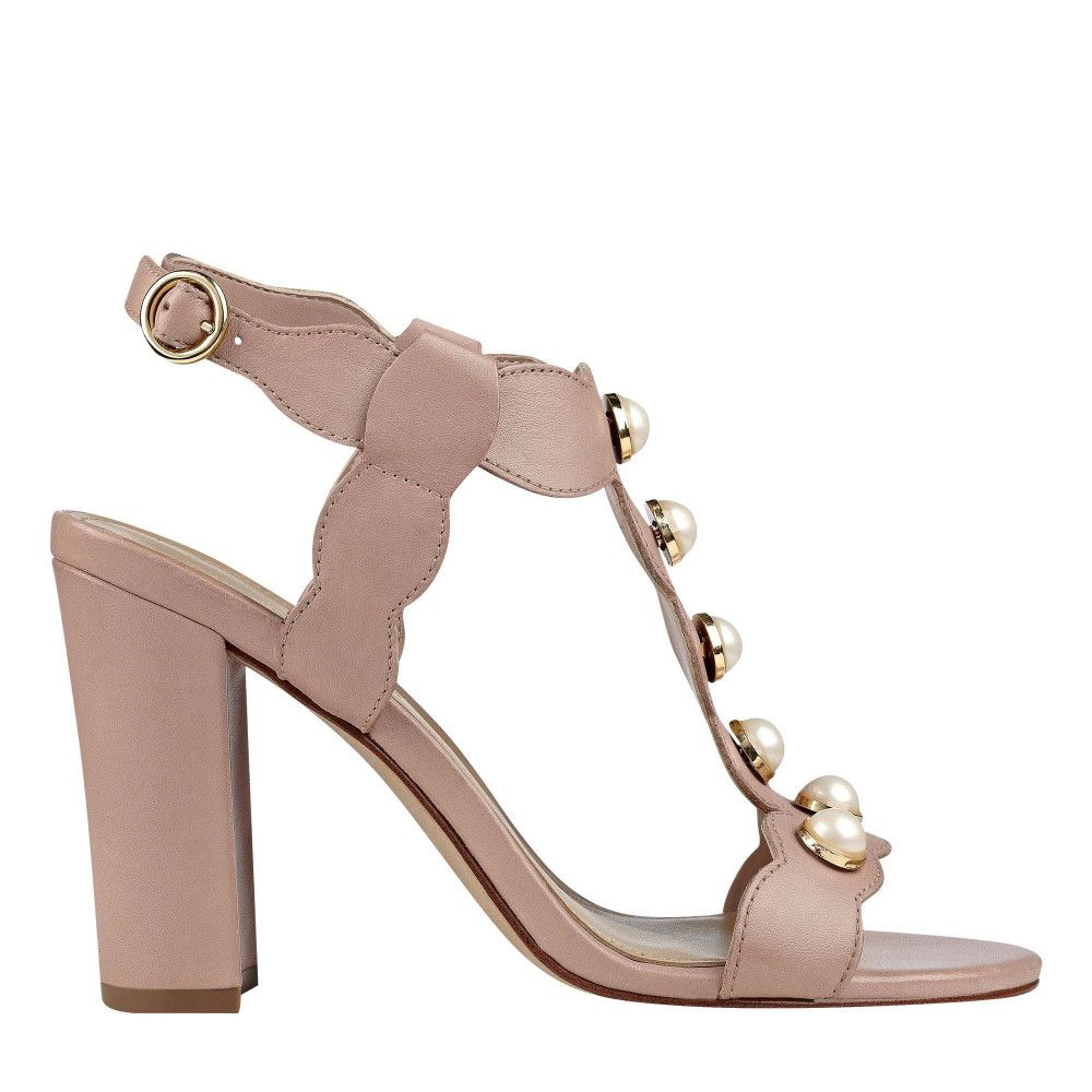 14cb85c8f140 Imitation pearls line the scalloped t-strap of these block heel sandals  with polished buckle