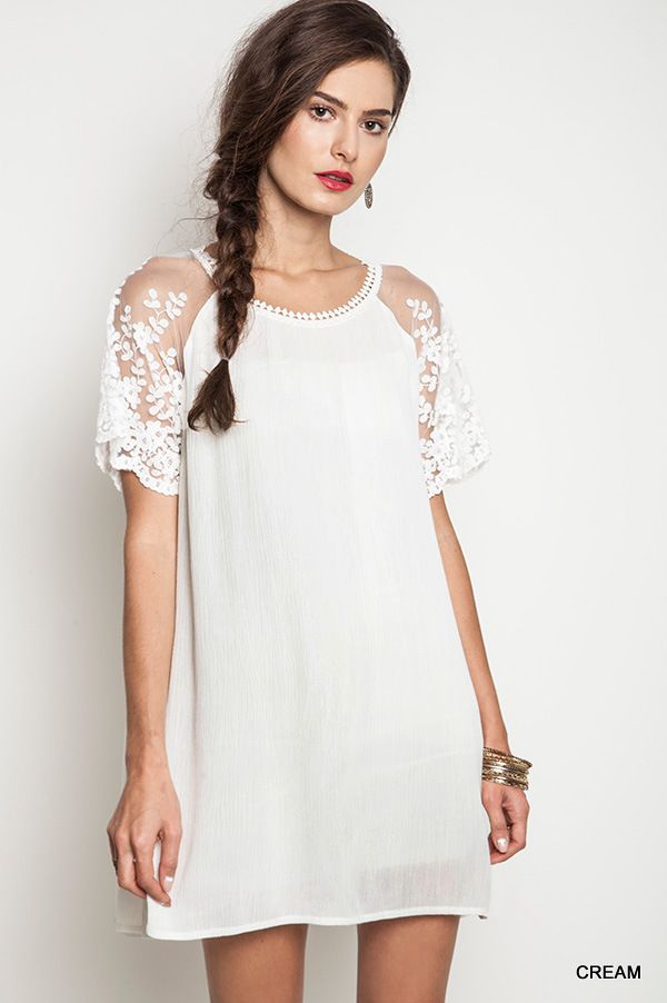 a8a71575a1b This cream color shift dress has such a chic touch with the delicate lace  sleeve.