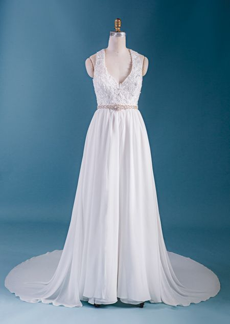 A woman wearing the Disney\'s Jasmine wedding gown from the Alfred ...
