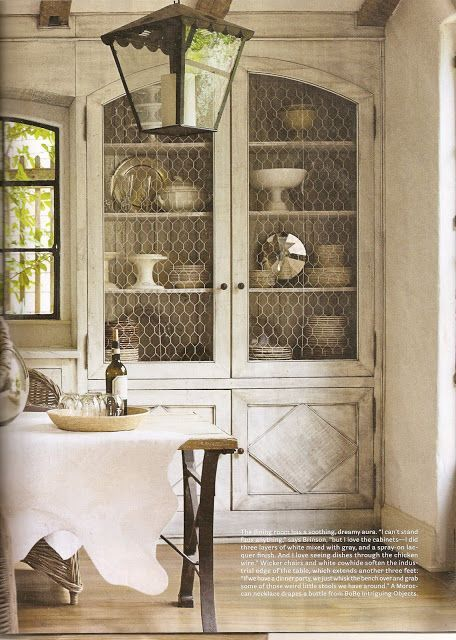 Built-in china cabinet with an antiqued finish and chicken wire.