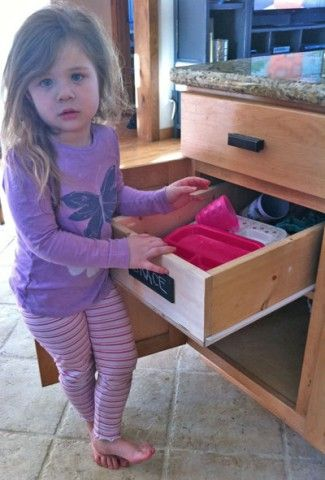 Wood Pullout Cabinet Drawer Organizer, would be great as a nightstand as well.