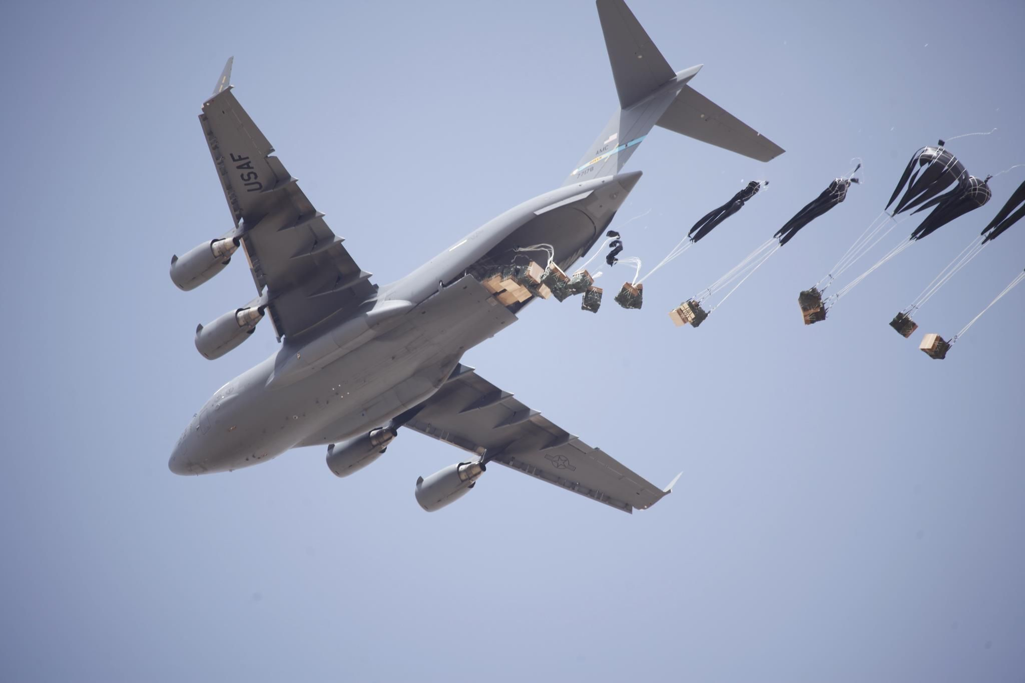 A C-17 Globemaster Airdrop over Afghanistan resupplies an US Army outpost.