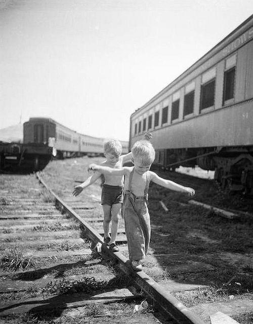 fuckyeahvintage-retro:  Boys playing on railroad tracks. NY,1948.