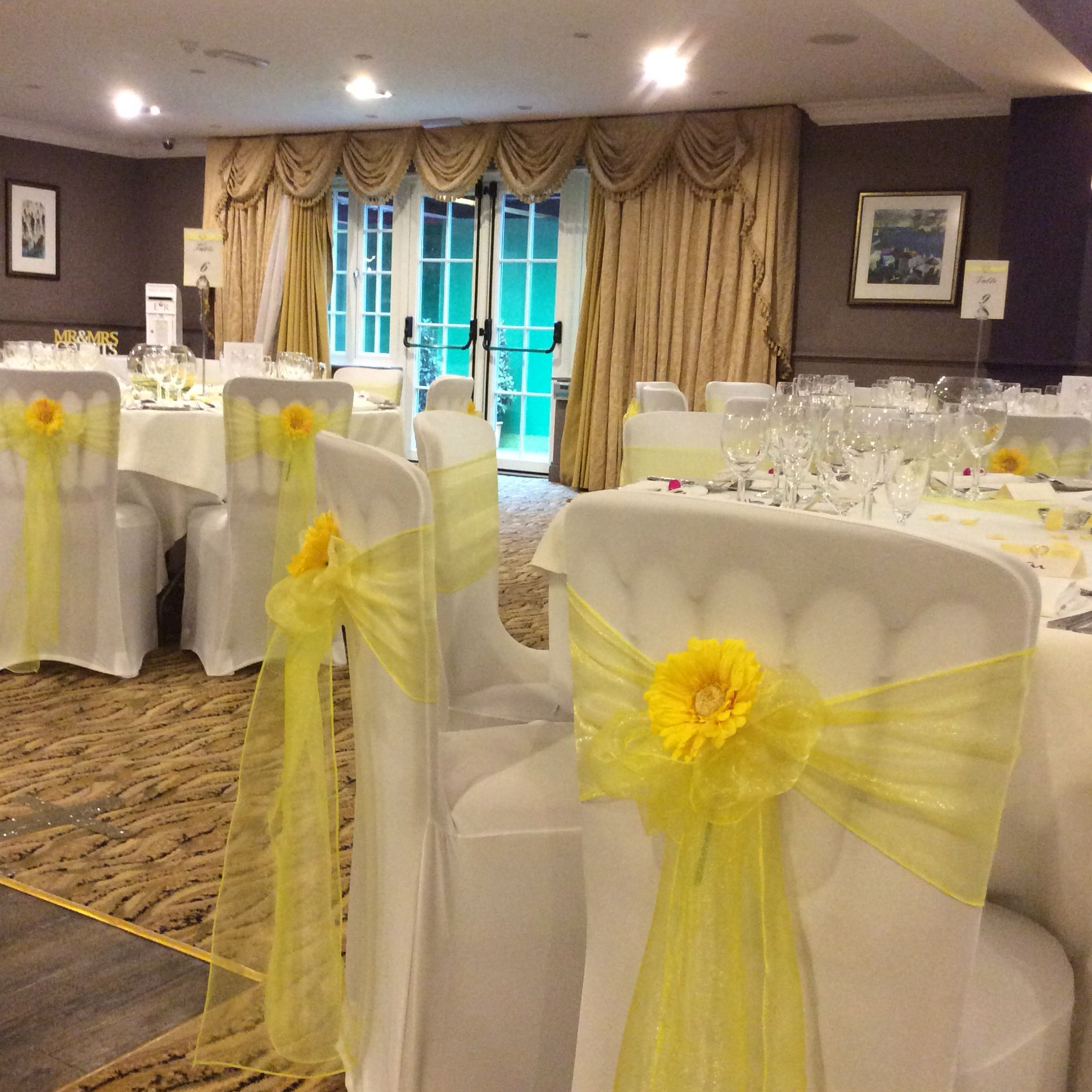 wedding chair cover hire wrexham cedar adirondack chairs plans lemon organza sash with yellow gerbera dressed on lycra covers sashes