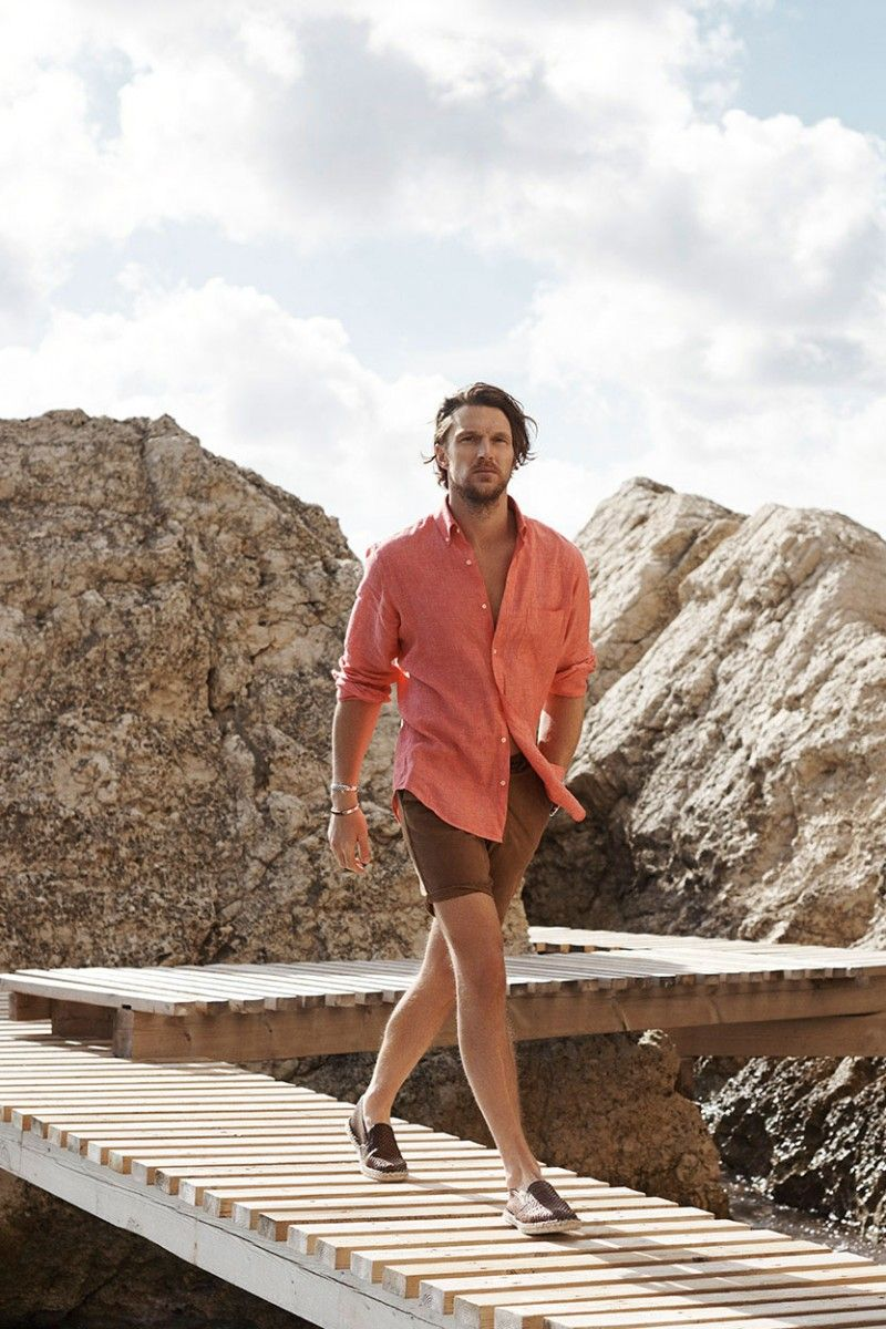 6702f31c74 Shaun DeWet models a salmon colored shirt with brown shorts and espadrilles  from Massimo Dutti.