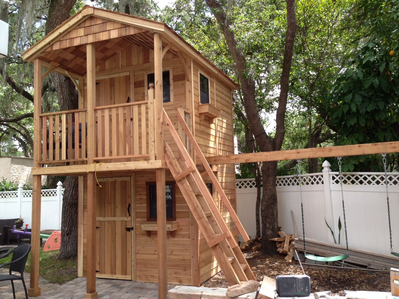 This beautiful two-story structure serves three functions - a storage shed for Dad on the first floor. a playhouse…   Shed playhouse. Play ...