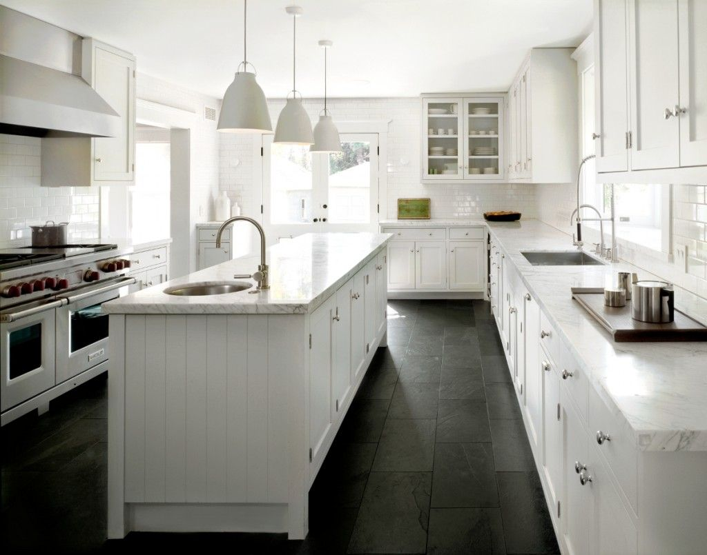 White classic kitchen with black slate floor and white pendants