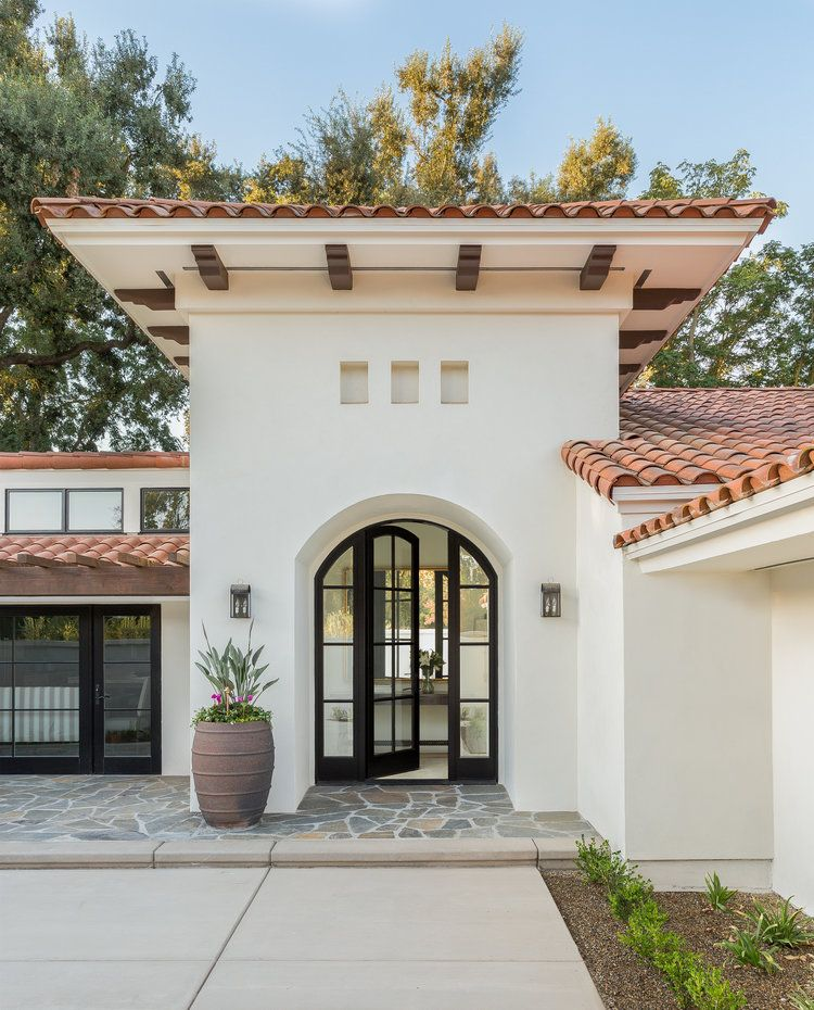 Modern Spanish Style Home With Black Arched Glass Door